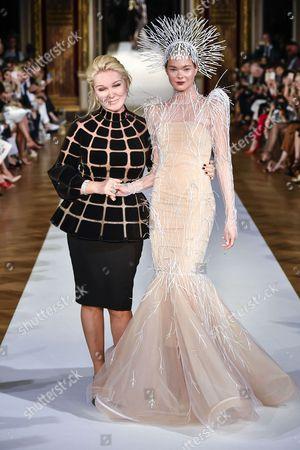 Yulia Yanina and model on the catwalk