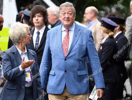 Stephen Fry and Elliot Spencer arrives at Wimbledon