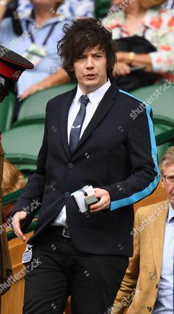 Elliot Spencer, husband of Stephen Fry, arrives in the Royal Box