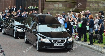 The Cortege Leaves The Cathedral. - Carla Lane Funeral At Liverpool Anglican Cathedral Liverpool Merseyside.