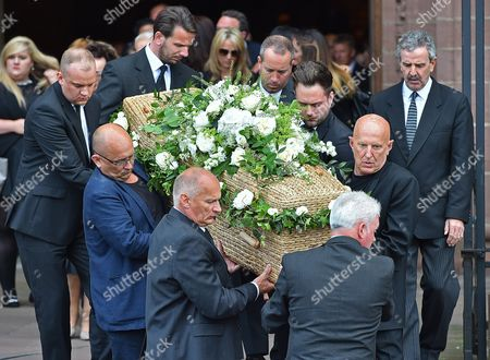 The Coffin Is Brought Out After The Service Carried By Sons Nigel Hollands (front L) And Carl Hollands (front Right-bald). - Carla Lane Funeral At Liverpool Anglican Cathedral Liverpool Merseyside.