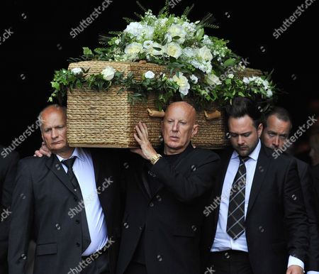 Sons Nigel (of Coffin) And Carl Hollands(r-bald - Carrying Coffin At Front) Carla Lane Funeral At Liverpool Anglican Cathedral Liverpool Merseyside.