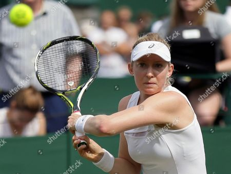 Julia Boserup of the United States returns to Shelby Rogers of the United States during their Women's Singles Match on day two at the Wimbledon Tennis Championships in London