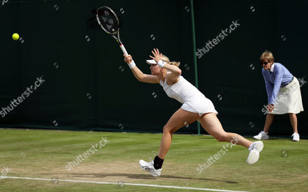 Stock Image of Julia Boserup of the United States returns to Shelby Rogers of the United States during their Women's Singles Match on day two at the Wimbledon Tennis Championships in London