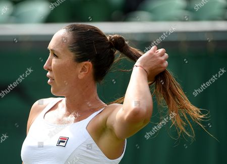 Jelena Jankovic of Serbia in action against Agnieszka Radwanska of Poland during their first round match for the Wimbledon Championships at the All England Lawn Tennis Club, in London, Britain, 04 July 2017.