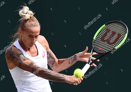 Polona Hercog of Slovenia returns to Annika Beck of Germany in their first round match during the Wimbledon Championships at the All England Lawn Tennis Club, in London, Britain, 04 July 2017.