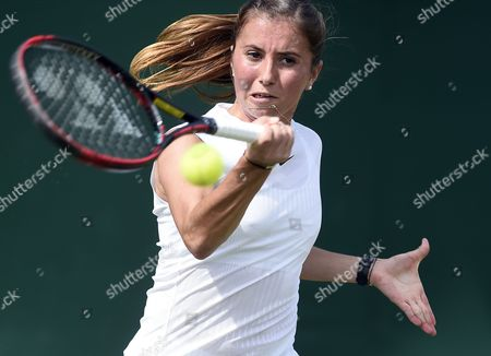 Annika Beck of Germany returns to Polona Hercog of Slovenia in their first round match during the Wimbledon Championships at the All England Lawn Tennis Club, in London, Britain, 04 July 2017.