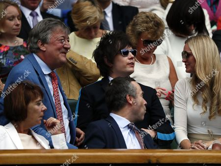 British actor Stephen Fry (L) and his partner Elliot Spencer (C) in the Royal Box on Centre Court during the Wimbledon Championships at the All England Lawn Tennis Club, in London, Britain, 04 July 2017.