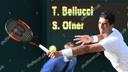 Thomaz Bellucci of Brazil returns to Sebastian Ofner of Austria in their first round match during the Wimbledon Championships at the All England Lawn Tennis Club, in London, Britain, 04 July 2017.