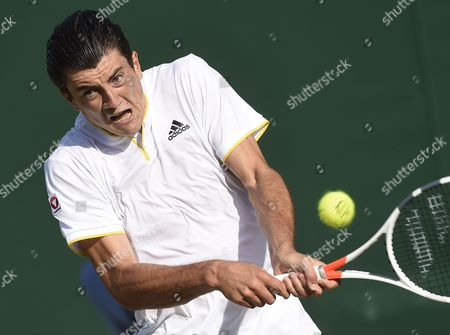 Sebastian Ofner of Austria returns to Thomaz Bellucci of Brazil in their first round match during the Wimbledon Championships at the All England Lawn Tennis Club, in London, Britain, 04 July 2017.