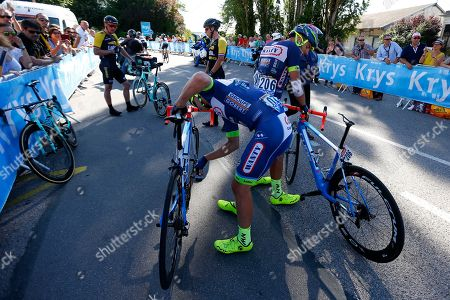 New Zealand's Dion Smith, left, and Italy's Andrea Pasqualon, right, Germany's Robert Wagner, rear left, and Netherlands' Dylan Groenewegen, rear center, get up after crashing during the fourth stage of the Tour de France cycling race over 207.5 kilometers (129 miles) with start in Mondorf-les-Bains, Luxembourg, and finish in Vittel, France