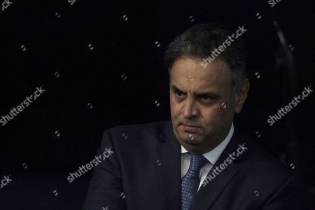 Brazil's Senator Aecio Neves, of the Brazilian Social Democracy Party, Wait to makes his defense statement at the Federal Senate in Brasilia, Brazil, . Neves returns today to the Senate after being suspended by the Brazilian Supreme Court for involvement in corruption scandals