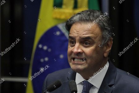 Brazil's Senator Aecio Neves, of the Brazilian Social Democracy Party, makes his defense statement at the Federal Senate in Brasilia, Brazil, . Neves returns today to the Senate after being suspended by the Brazilian Supreme Court for involvement in corruption scandals