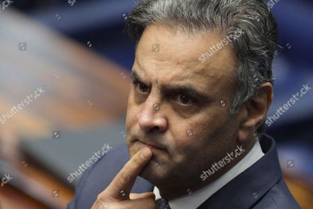 Stock Picture of Brazil's Senator Aecio Neves, of the Brazilian Social Democracy Party, takes moment before making his defense statement at the Federal Senate in Brasilia, Brazil, . Neves returns today to the Senate after being suspended by the Brazilian Supreme Court for involvement in corruption scandals