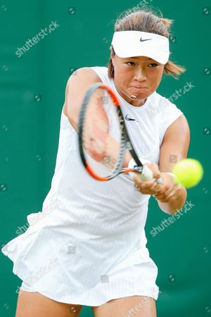 Xinyun Han (CHN) - Tennis : Xinyun Han of China during the Women's singles first round match of the Wimbledon Lawn Tennis Championships against Zarina Diyas of Kazakhstan at the All England Lawn Tennis and Croquet Club in London, England.