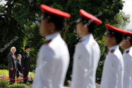 Hassanal Bolkiah, Tony Tan Brunei's Sultan Hassanal Bolkiah, center, stands with Singapore's President Tony Tan, left, as they inspect the honor guard during a welcome ceremony at the Istana, in Singapore