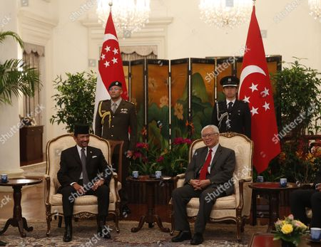 Hassanal Bolkiah and Tony Tan Keng Yam