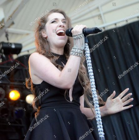 Stock Image of Lead singer Saxony Raine of the band Revel in Romance performs live at Henry Maier Festival Park during Summerfest in Milwaukee, Wisconsin