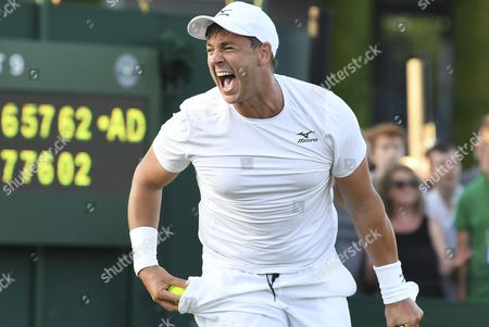 Marcus Willis (GBR) celebrates after winning a doubles match with Jay Clarke (GBR)