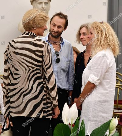 Italian Defence Minister Roberta Pinotti (L) talks with Paolo Villaggio's children Pierfrancesco (C) and Elisabetta (R) as she pays her respects to the late Italian actor Paolo Villaggio inside the City Hall in Rome, Italy, 05 July 2017. A non-religious funeral will be held at Rome's Casa del Cinema (Home of Cinema) center later the same day. Italian actor, writer and director Paolo Villaggio, one of the greats of the Italian comedy, died at a Rome clinic on 03 July at the age of 84.