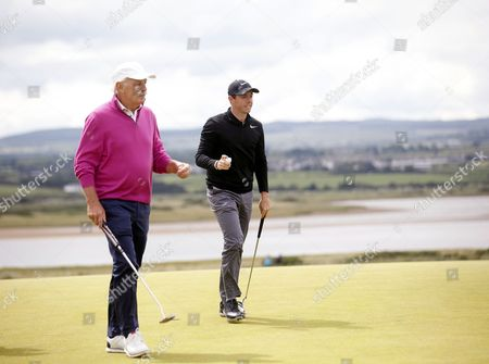 Rory McIlroy and Dermot Desmond on the 6th green