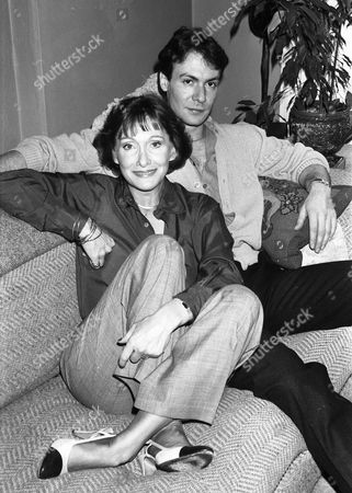 Stock Picture of Actress Sian Phillips, real name Dame Jane Elizabeth Ailwen Phillips DBE, with third husband Robin Sachs. pictured at their London home in January 1985.