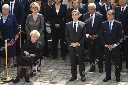 Stock Image of Former first lady Bernadette Chirac and his daughter Claude Chirac, Former French Presidents Nicolas Sarkozy and Francois Hollande attend during a funeral ceremony for Simone Veil, in the courtyard of the Invalides in Paris, France, 05 July 2017. Holocaust survivors are joining France's president and European dignitaries at a special memorial ceremony for Simone Veil, who rose from the horrors of Nazi death camps to become president of the European Parliament and one of France's most revered politicians.