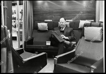 Dr Richard Beeching Chairman Of British Railways Relaxes In A Mock-up Of A New Design For A First-class Lounge On High-speed Trains Expected To Be Introduced By 1966. Ironically He Was To Be Remembered For Axing Hundreds Of Rail Services Across Britain.