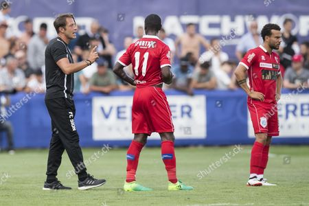 Sion's head coach Paolo Tramezzani (L) talks to Sion's Kevin Constant (C) and Sion's Nicolas Luechinger (R) during a friendly soccer match between FC Sion from Switzerland and Olympique de Marseille from France at the Saint-Laurent stadium, in Saillon, Switzerland, 05 July 2017.