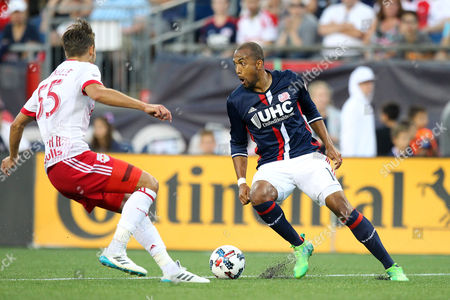 , 2017; Foxborough, MA, USA; New England Revolution forward Teal Bunbury (10) and New York Red Bulls defender Damien Perrinelle (55) in action during the first half of an MLS match between New York Red Bulls and New England Revolution at Gillette Stadium. New York won 3-2