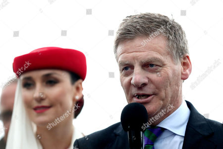 New Zealand Prime Minister Bill English makes a speech during the Team New Zealand Americas Cup Welcome Home Parade in Auckland, New Zealand