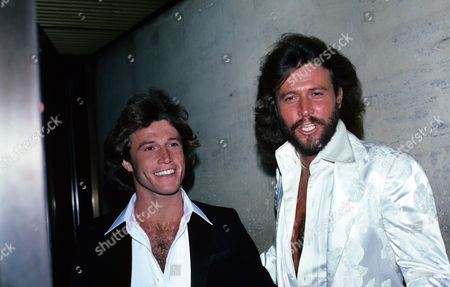 Andy Gibb and Barry Gibb of the Bee Gees Are Photographed at a Grammy Party Held at the Four Seasons in the 1990s