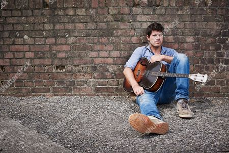 Yelverton United Kingdom - August 17: Portrait Of English Musician Seth Lakeman Photographed With His Vintage Harmony Master Acoustic Guitar Near His Home In Devon On August 17