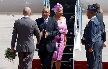 President of South Africa, Jacob Zuma (2-L) and his wife Thobeka Madiba-Zuma (3-L), arrive at the Hamburg International Airport ahead of the G20 summit in Hamburg, Germany, 06 July 2017. The G20 Summit (or G-20 or Group of Twenty) is an international forum for governments from 20 major economies. The summit is taking place in Hamburg 07 to 08 July 2017.