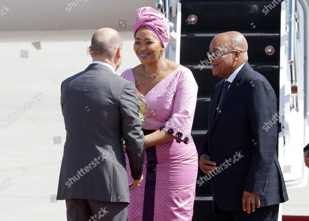 Thobeka Madiba Zuma, wife of South Africa's President Jacob Zuma, right, is welcomed by Hamburg mayor Olaf Scholz, left, as they arrive for the G-20 summit in Hamburg, northern Germany, . The leaders of the group of 20 meet July 7 and 8
