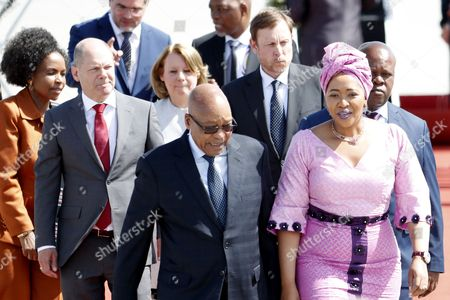 President of South Africa, Jacob Zuma (C), and his wife, Thobeka Madiba-Zuma, (R) arrive at the Hamburg International Airport ahead of the G20 summit in Hamburg, Germany, 06 July 2017. The G20 Summit (or G-20 or Group of Twenty) is an international forum for governments from 20 major economies. The summit is taking place in Hamburg 07 to 08 July 2017.