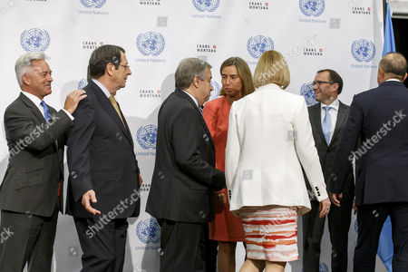 (L-R) British European Affairs Minister Alan Duncan, Cypriot President Nicos Anastasiades, UN Secretary-General Antonio Guterres, European Union Foreign Policy Chief Federica Mogherini, UN Secretary-General Special Representative and Head of the United Nations Peacekeeping Force in Cyprus Elizabeth Spehar, UN Special Advisor of the Secretary-General of Cyprus Espen Barth Eide, and Turkish Foreign Minister Mevlut Cavusoglu, leave the group picture, prior beginning a meeting of the conference on Cyprus under the auspices of the United Nations, in Crans-Montana, Switzerland, 06 July 2017.