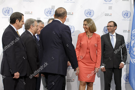 (L-R) Cypriot President Nicos Anastasiades, UN Secretary-General Antonio Guterres, Turkish Cypriot leader Mustafa Akinci, Greek Foreign Minister Nikos Kotzias, Turkish Foreign Minister Mevlut Cavusoglu, European Union Foreign Policy Chief Federica Mogherini, and UN Special Advisor of the secretary general of Cyprus Espen Barth Eide leave, leave the group picture, prior a meeting of the conference on Cyprus under the auspices of the United Nations, in Crans-Montana, Switzerland, 06 July 2017.
