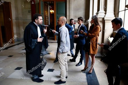French lawyer Patrick Klugman, left, representing Latvian bank, Rietumu Banka, talks to the media at the Palais de Justice courthouse in Paris, France, . A Paris court has heavily fined Rietumu Banka for laundering hundreds of millions of euros through a vast scheme allowing French taxpayers to evade taxes with the complicity of a French financier, Nadav Bensoussan