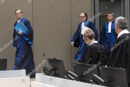 Presiding judge Cuno Tarfusser of Italy (C), judge Chang-ho Chung of Korea (R), and judge Marc Perrin de Brichambautat of France (L), in the International Criminal Court (ICC) in The Hague, Netherlands, 06 July 2017. Judges delivered a decision in the case against Sudan's president Omar Hassan Ahmad Al Bashir who was indicted by the ICC in 2009 and 2010. The ICC on 06 July 2017, delivered in open session its decision finding that South Africa failed to comply with its obligations by not arresting and surrendering Omar Al-Bashir to the Court while he was on South African territory between 13 and 15 June 2015. However, the Chamber considered that it is not warranted to refer South Africa's non-compliance to the Assembly of States Parties ('ASP') or the Security Council of the United Nations ('UNSC').