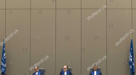(L-R) Presiding judge Cuno Tarfusser of Italy, judge Chang-ho Chung of Korea-, and judge Marc Perrin de Brichambautat of France, sitting in the International Criminal Court (ICC) in The Hague, Netherlands, 06 July 2017. Judges delivered a decision in the case against Sudan's president Omar Hassan Ahmad Al Bashir who was indicted by the ICC in 2009 and 2010. The ICC on 06 July 2017, delivered in open session its decision finding that South Africa failed to comply with its obligations by not arresting and surrendering Omar Al-Bashir to the Court while he was on South African territory between 13 and 15 June 2015. However, the Chamber considered that it is not warranted to refer South Africa's non-compliance to the Assembly of States Parties ('ASP') or the Security Council of the United Nations ('UNSC').