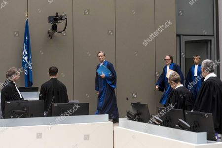 Stock Photo of Presiding judge Cuno Tarfusser of Italy (C), judge Chang-ho Chung of Korea (R), and judge Marc Perrin de Brichambautat of France (L), in the International Criminal Court (ICC) in The Hague, Netherlands, 06 July 2017. Judges delivered a decision in the case against Sudan's president Omar Hassan Ahmad Al Bashir who was indicted by the ICC in 2009 and 2010. The ICC on 06 July 2017, delivered in open session its decision finding that South Africa failed to comply with its obligations by not arresting and surrendering Omar Al-Bashir to the Court while he was on South African territory between 13 and 15 June 2015. However, the Chamber considered that it is not warranted to refer South Africa's non-compliance to the Assembly of States Parties ('ASP') or the Security Council of the United Nations ('UNSC').
