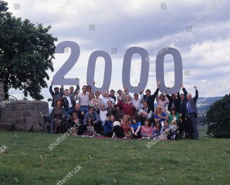 Stock Picture of Emmerdale cast photgraph celebrating it's 2000th episode.  [Top l-r] Zak Dingle, as played by Steve Halliwell ; Biff Fowler, as played by Stuart Wade ; Sam Dingle, as played by James Hooton ; Ned Glover, as played by Johnny Leeze ; Jan Glover, as played by Roberta Kerr ; Daniel Weir, as played by Matthew Marsden ; Amos Brearly, as played by Ronald Magill ; Terry Woods, as played by Billy Hartman; Seth Armstrong, as played by Stan Richards ; Betty Eagleton, as played by Paula Tilbrook ; Alan Turner, as played by Richard Thorp ; Frank Tate, as played by Norman Bowler ; Chris Tate, as played by Peter Amory ; Kim Tate, as played by Claire King ; Vic Windsor, as played by Alun Lewis ; Viv Windsor, as played by Deena Payne ; Eric Pollard, as played by Christopher Chittell.  [Bottom l-r] Nellie Gough, as played by Sandra Gough ; Butch Dingle, as played by Paul Loughran ; Tina Dingle, as played by Jacqueline Pirie ; Dave Glover, as played by Ian Kelsey ; Jack Sugden, as played by Clive Hornby ; Sarah Sugden, as played by Alyson Spiro ; Linda Glover, as played by Tonicha Jeronimo ; Rachel Tate, as played by Glenda Mackay; Dolores Sharp, as played by Samantha Hurst ; Kathy Tate, as played by Malandra Burrows.