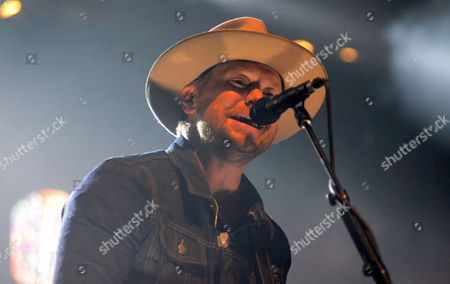 Stock Photo of Lead singer Bear Rinehart of the band Needtobreathe performs live at Henry Maier Festival Park during Summerfest in Milwaukee, Wisconsin