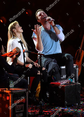 Chris Martin, Shakira Singers Chris Martin, right, and Shakira perform at the Global Citizen Festival concert on the eve of the G-20 summit in Hamburg, northern Germany, . The leaders of the group of 20 meet July 7 and 8