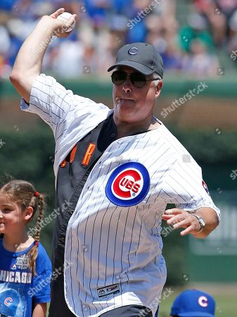 Stock Photo of Actor William Petersen throws out the ceremonial first pitch before a baseball game between the Milwaukee Brewers and the Chicago Cubs, in Chicago