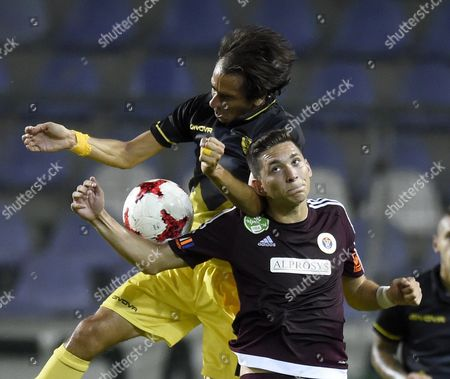 Yossi Benayoun (L) of Beitar Jerusalem and Mate Vida of Vasas in action during the UEFA Europa League first qualifying round, second leg soccer match between Vasas and Beitar Jerusalem at the Szusza Ferenc Stadium in Budapest, Hungary, 06 July 2017.