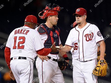 Joe Blanton, Dusty Baker, Matt Wieters Washington Nationals relief pitcher Joe Blanton (56) is pulled from the game by manager Dusty Baker (12) as catcher Matt Wieters waits during the eighth inning of the team's baseball game against the Atlanta Braves, early, in Washington. The Braves won 5-2