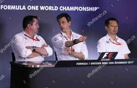 Head of Mercedes-Benz Motorsport Torger 'Toto' Wolff talks with McLaren team principal Eric Boullier, left, as Yuseke Hasagawa, right, head of Honda Formula One, looks on during a press conference after the second practice session for the Austrian Formula One Grand Prix at the Red Bull Ring in Spielberg, Austria, . The Austrian Grand Prix will be held on Sunday