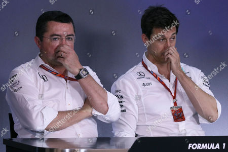 Head of Mercedes-Benz Motorsport Torger 'Toto' Wolff, right, and McLaren team principal Eric Boullier listen during a press conference after the second practice session for the Austrian Formula One Grand Prix at the Red Bull Ring in Spielberg, Austria, . The Austrian Grand Prix will be held on Sunday
